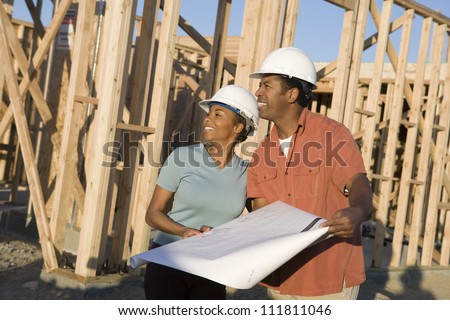 African American couple at construction site