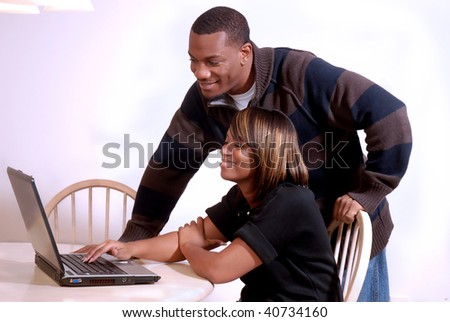 African-American couple enjoying the internet together - stock photo
