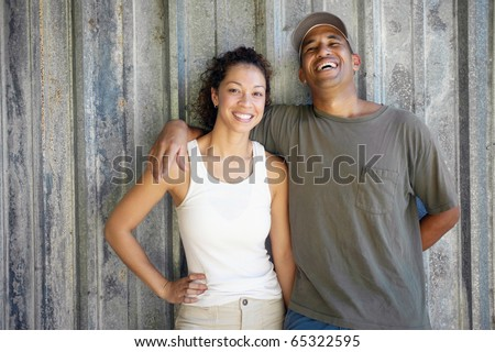 African American couple hugging and smiling - stock photo