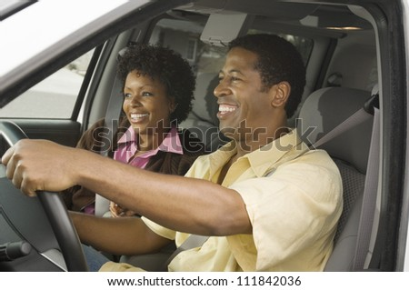 African American couple in a car - stock photo