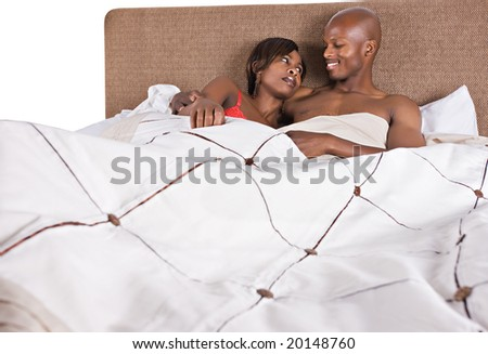 african american couple in bed having fun - stock photo