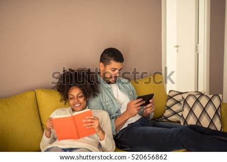 African american couple relaxing at home together.