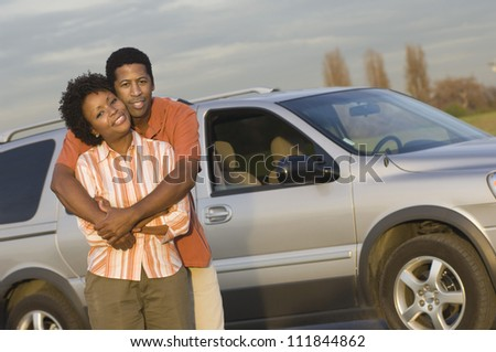 African American couple standing in front a car - stock photo