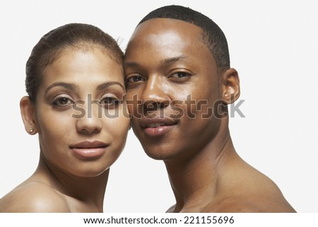 African American couple touching faces - stock photo
