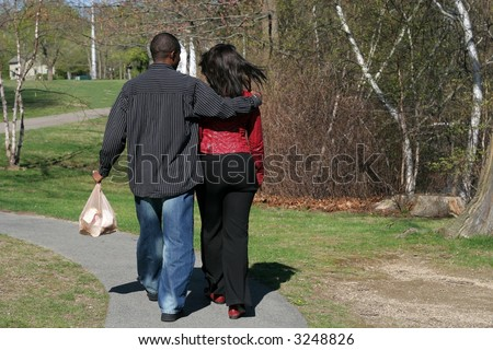 african american couple walking in park