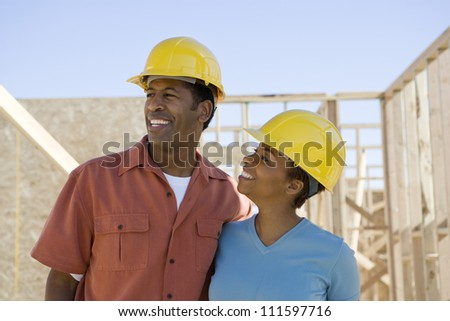 African American couple with blueprint