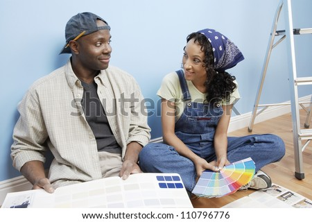 African American couple with color samples - stock photo