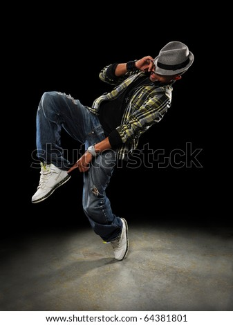 African American dancer performing over dark background - stock photo