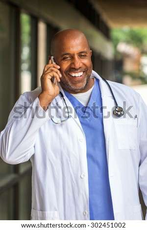 African American doctor on the phone - stock photo