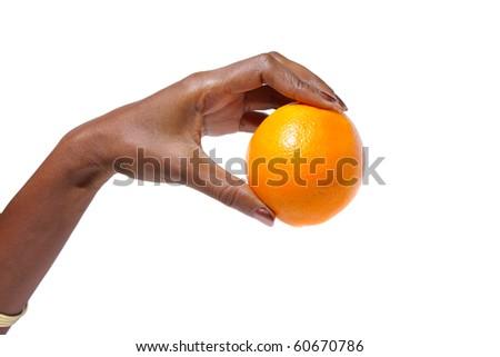 African American Elegant female hand holding a orange over white background - stock photo
