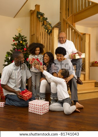 African American family exchanging Christmas gifts