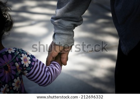 African-American Family: father and child holding hands - stock photo