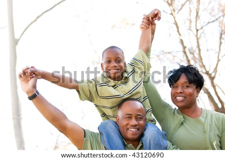African American Family Having Fun in the Park. - stock photo