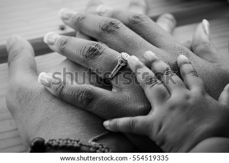 African American Holding Hands In Black And White