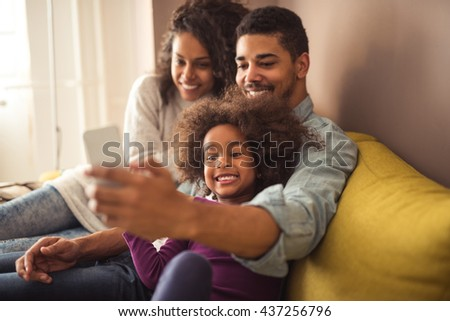 African american family making a selfie together. - stock photo