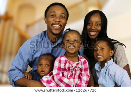 African American family together inside their home - stock photo