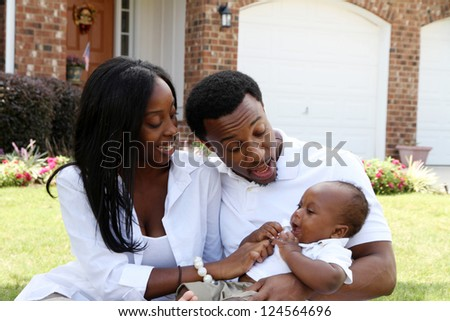 African American family together outside their home - stock photo