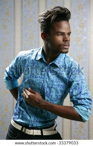 African american fashion model portrait on blue wallpaper background - stock photo