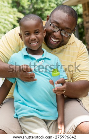 African American father and son spending time together. - stock photo