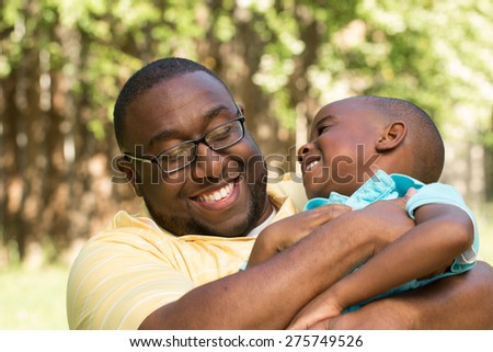 African American father and son talking. - stock photo