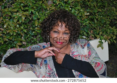 African american female beauty expressions outside. - stock photo