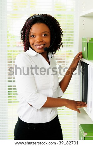 African American Female Call Center Agent Wearing A Telephone Headset - stock photo