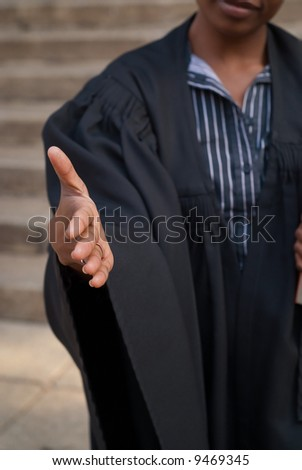 African American female woman lawyer shaking hands outside court house - stock photo