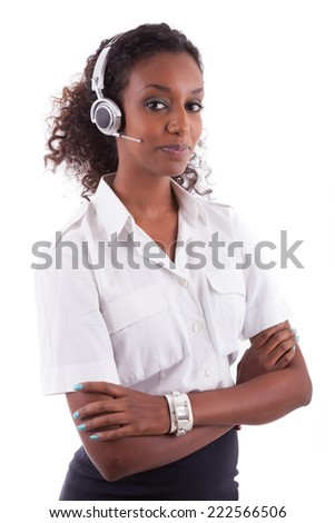 African American helpdesk worker holding headset - Black people - stock photo