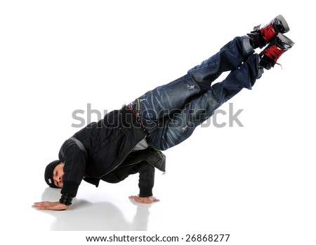 African American hip hop dancer performing a side hand and head stand - stock photo