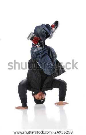 African American hip hop dancer performing headstand - stock photo