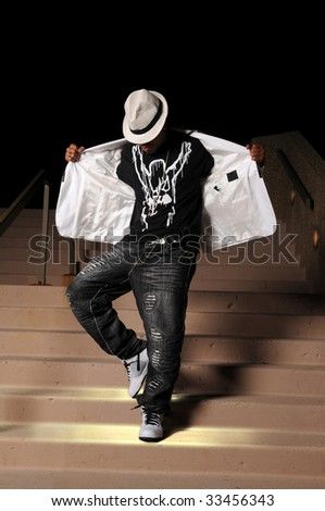 African American hip hop dancer performing on stairs - stock photo