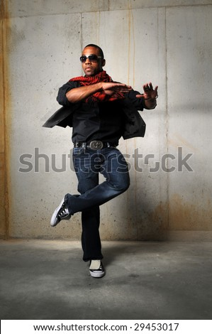 African American hip hop dancer performing over a grunge background - stock photo