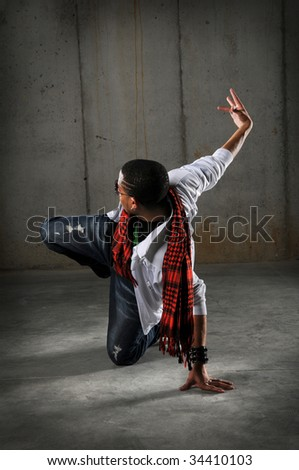African American hip hop dancer performing over grunge background - stock photo