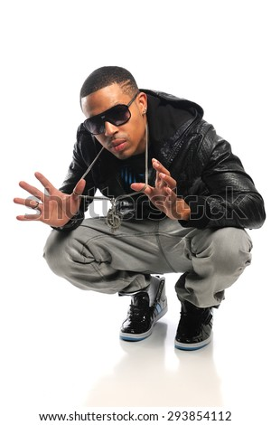 African American hip hop dancer showing jewelry isolated over white background - stock photo