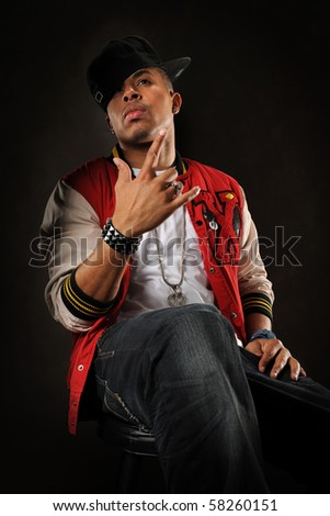 African American hip hop man posing over dark background - stock photo