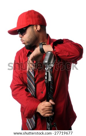 African American hip hop musician posing with vintage microphone - stock photo