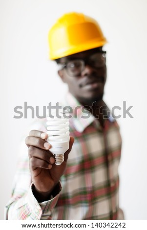 African American in a construction helmet
