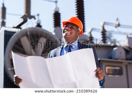african american industrial manager in electric substation