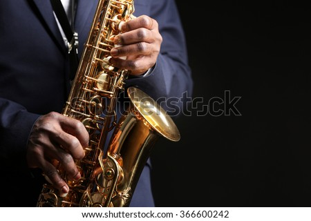 African American jazz musician playing the saxophone, closeup - stock photo