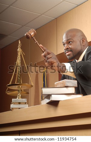 African American judge making a decision in his court - stock photo