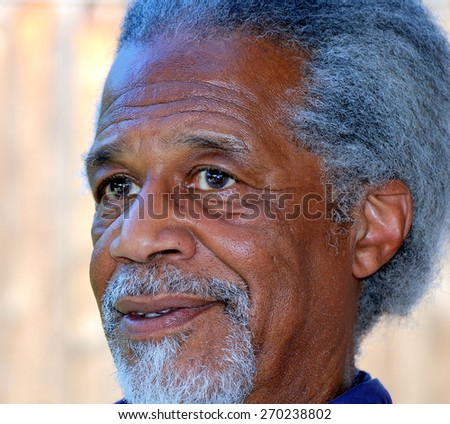 African american male expressions alone outdoors. - stock photo