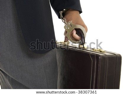 African American male hand holding a briefcase while handcuffed to it. - stock photo