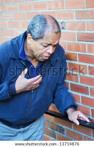 African American male having chest pains. - stock photo
