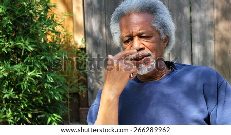 African american male relaxing outside alone. - stock photo