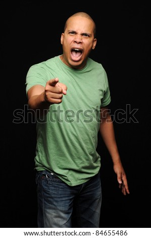 African American Male with angry expression pointing finger - stock photo