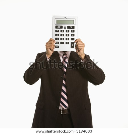 African American man holding oversized calculator over his face. - stock photo