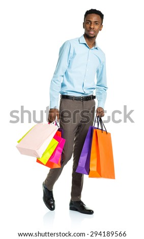 African american man holding shopping bags on white background. Shopping and holidays concept - stock photo