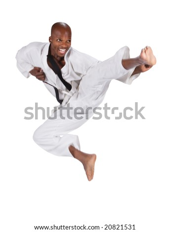 african american man in karate suit, suspended in mid air - stock photo