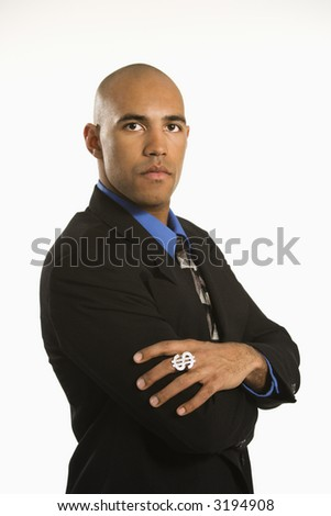 African American man in suit wearing ring with money sign. - stock photo
