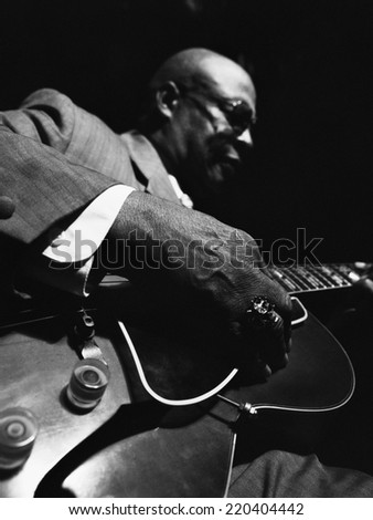 African American man playing guitar - stock photo